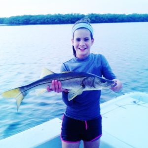 Girl with fish on inshore Bradenton fishing charter