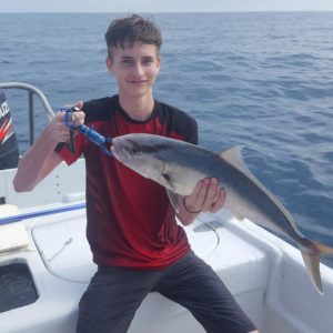 Boy with fish on offshore Bradenton Fishing Charter