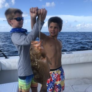 Children fishing offshore on Holmes Beach fishing charter