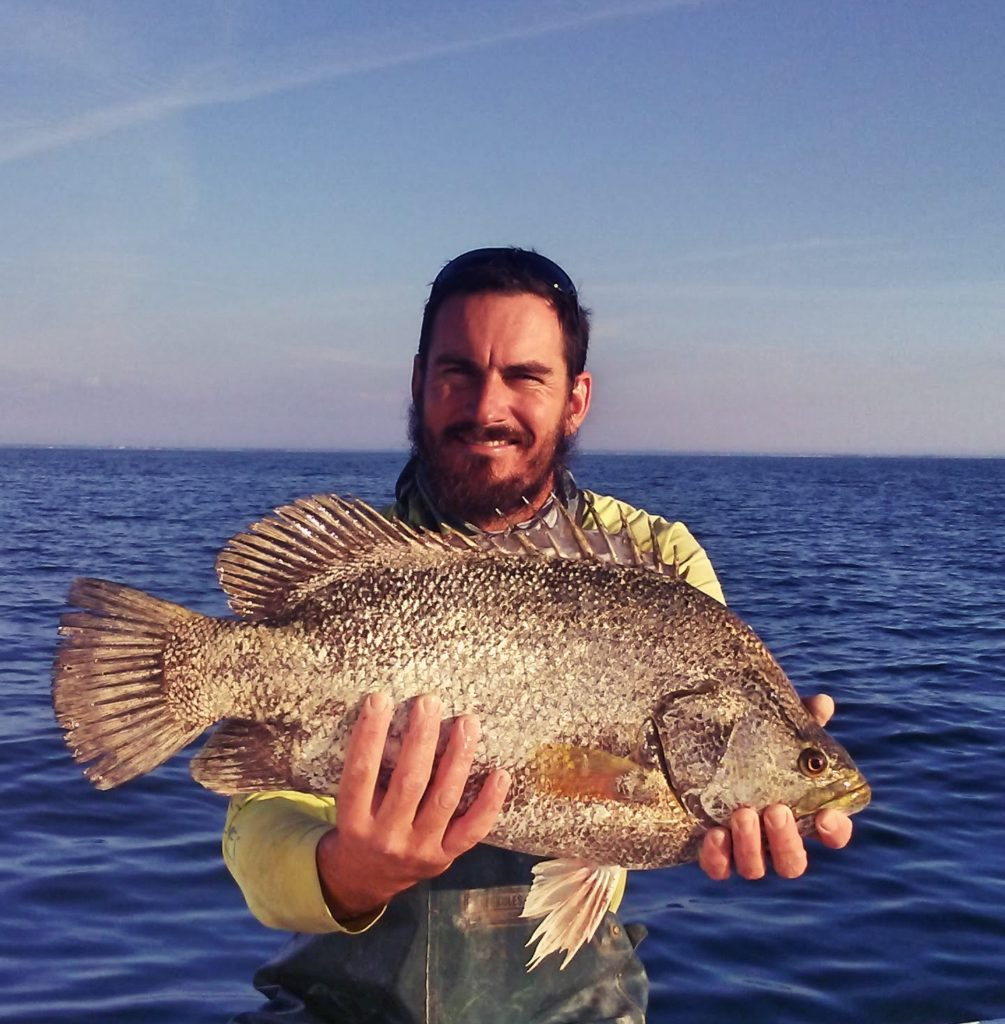 Man with fish on Bradenton Fishing Charter offshore