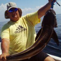 Man holding large fish from deep sea fishing
