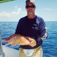 Man holding hogfish on fishing charter at Anna Maria Island