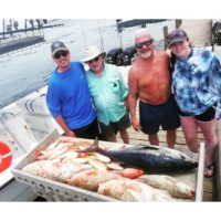 family over fish caught from deep sea fishing